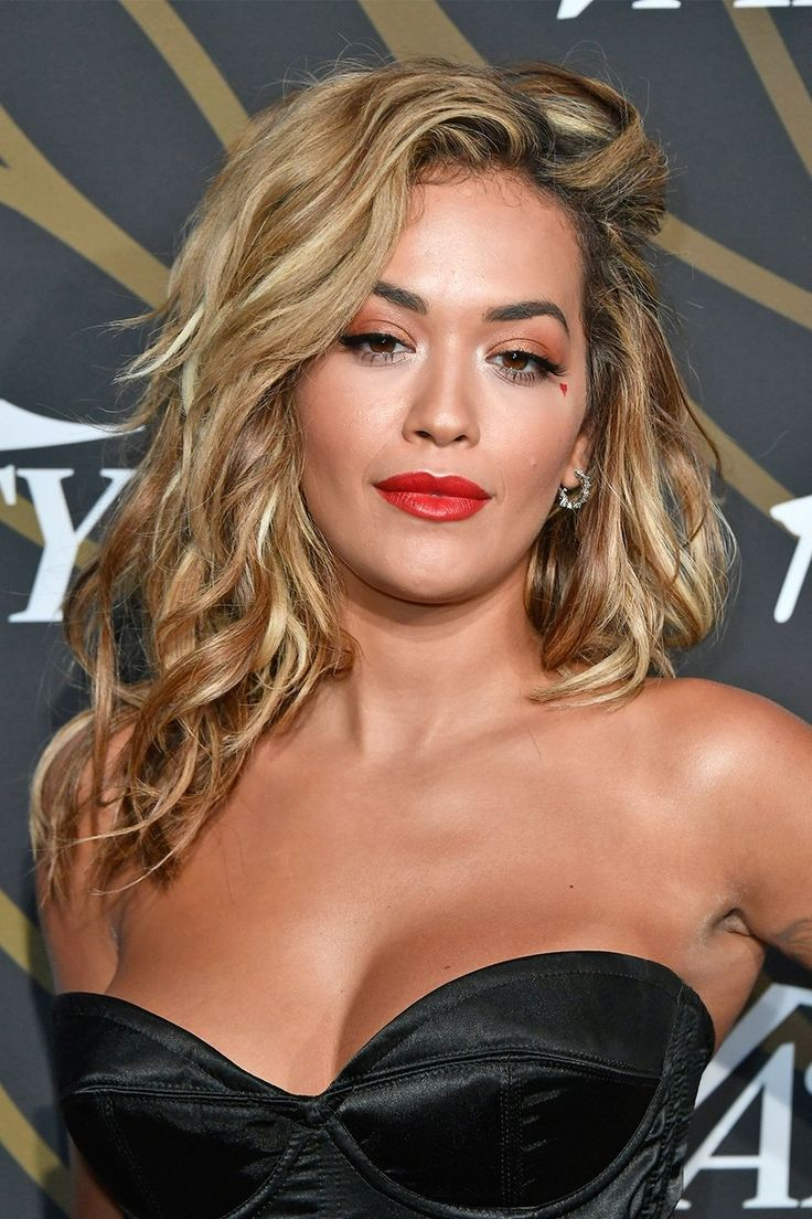 The key to Rita Ora's color? Dozens of copper, platinum, and bronze highlights, mixed together. Find out the prettiest hair color trends you're going to see in 2018 here!