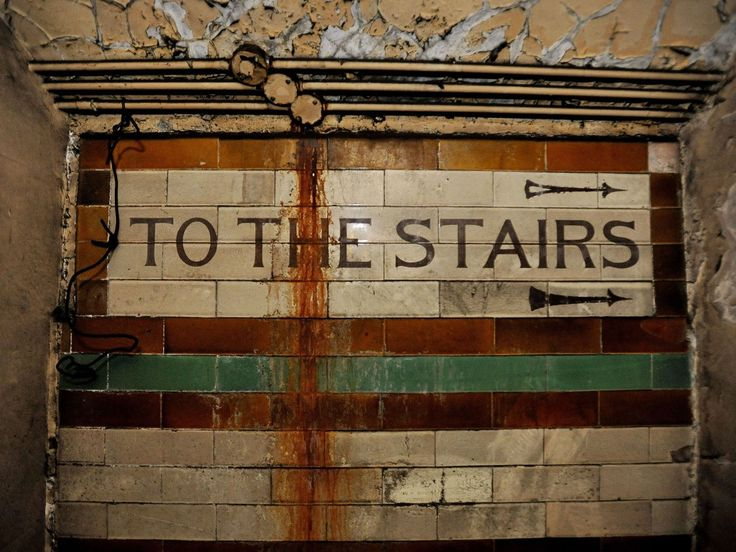 A tiled sign on a wall inside the disused Brompton Road tube station, London. This tube station is for sale!