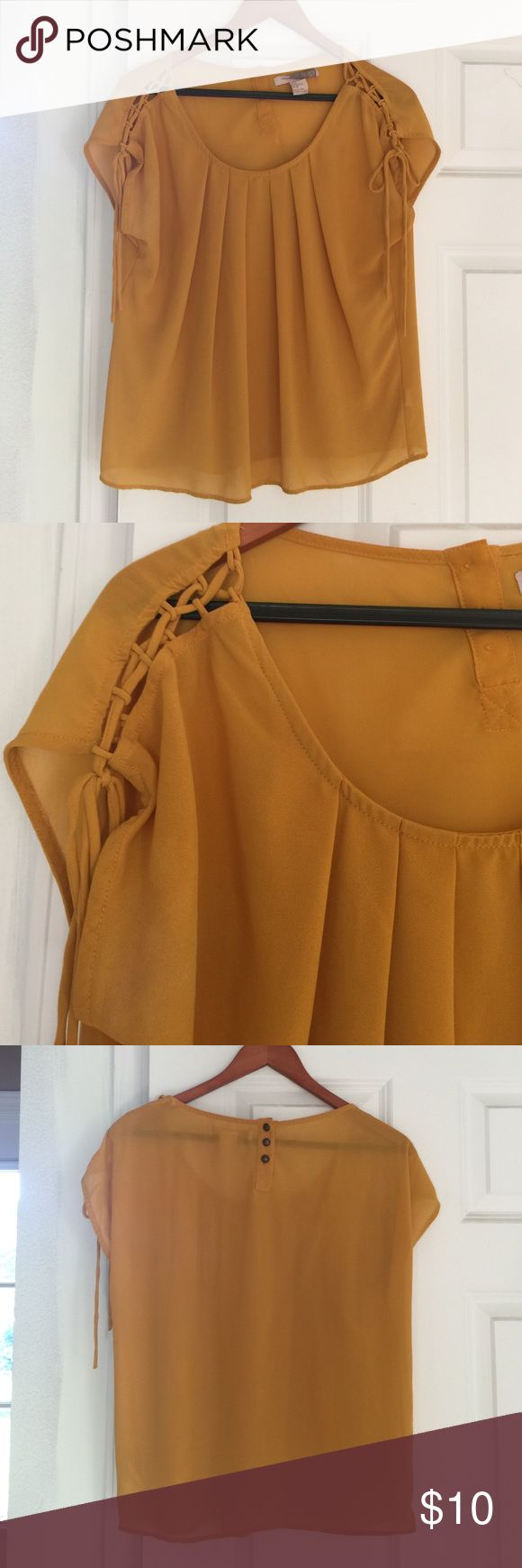 Dark mustard yellow lady's shirt Dark mustard yellow lady's shirt. Featuring pleated front, corseted sleeves and thee buttons on back nape of neck. It's the same exact color as depicted below. Tops Tees - Short Sleeve