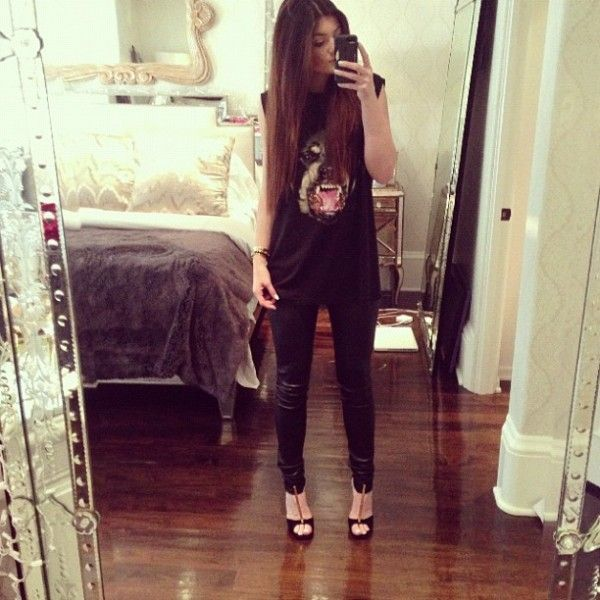 Kylie Jenner Outfit of the Day Instagram- In love. Heels, Leather Leggings, long straight soft hair, with a tank top.