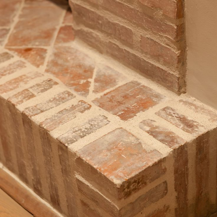 Bricks and white cement making of a hearth