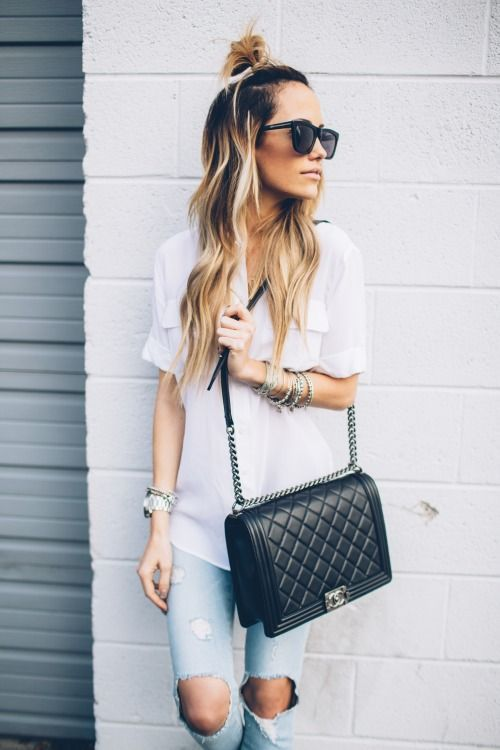 Top knot, white skirt, and CHANEL all day.
