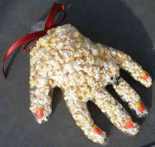 Sweet Scary Hand:   Put one candy corn into the tip of each finger of a clear plastic glove.   Fill the glove with popped popcorn & tie off with a ribbon.