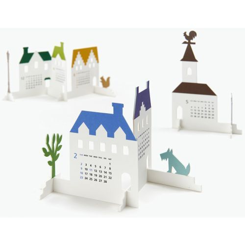 Town Build Your Own 2014 Calendar | Weird & Interesting | CALENDARS.COM - $24.00 Town is a paper craft kit with parts that can be freely assembled into a calendar. Put together buildings in different forms and enjoy creating your very own little town. Town is a calendar paper craft kit with parts that can be added as month goes by to create e little town. Feel free to assemble and fit parts fashioned into buildings together with various accessory kit.