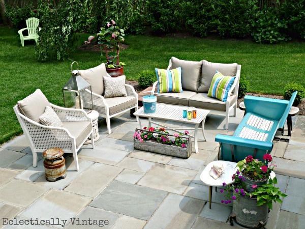 This eclectic out door living room and it's perfection of old and new and colors is now my inspiration for my backyard.  I have allready cleared an area and love the way this large pavers or large stone looks.  Great job Kelly