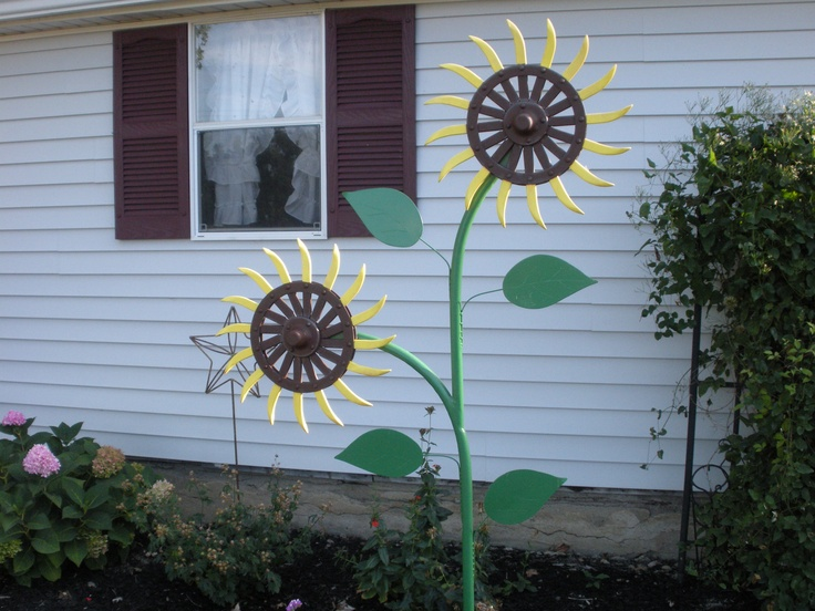 Sunflower made from John Deere rotary hoe wheels yard
