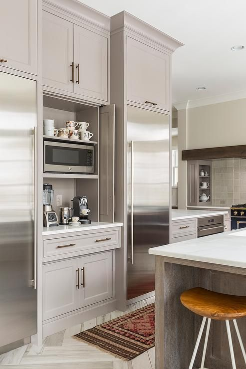 Coffee station with pocket doors. Great idea for organization in the kitchen