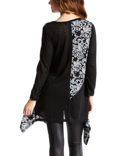 A linen-cotton blend brings breathable texture to this patchwork tunic, and floral accents add feminine appeal.