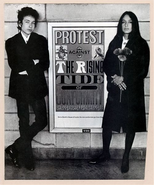 In 1964, Bob Dylan and Joan Baez were photographed at Newark Airport in front of Seymour Chwast's poster for Booth's Gin: an incongruous image of two icons flanking a countercultural message from a corporate advertiser. Image courtesy of the SVA Picture Collection.