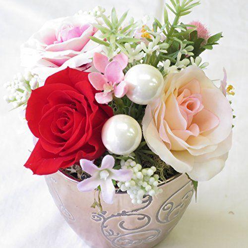 女性の誕生日 プレゼントに最適なお花。 プリザーブドフラワーとアートフシャルフラワー(造花)のフラワーアレンジメント。誕生日 プレゼント 女性 敬老の日 プレゼントへのフラワー※水やり不要。長期間保存可能。花の写真はイメージです。手作りの為、花 バラの色その他の花材は一部変更される場合があります。ピンクシルバーのオシャレな陶器 サンモクスイ http://www.amazon.co.jp/dp/B00USXLN1Y/ref=cm_sw_r_pi_dp_tZU4vb0Y9BFQH