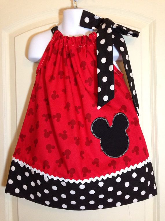 This is not a licensed Disney product. It is however, hand-crafted by me in my smoke and pet free home studio from licensed Disney fabric. I am not affiliated with or sponsored by Disney Enterprises.  An adorable dress for your young lady. Just in time to wear to Disney World when she meets Mickey and Minnie...Two styles to choose from....Red Mickey ears print fabric top with small or large dotted black bottom band. With matching one or two shoulder fabric ties and added appliqued Mickey…