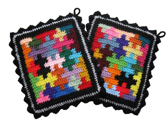 crochet Pot Holders. love this jigsaw design would look great as a kaffe fassett style jumper or shawl or jacket wear the rainbow