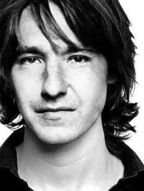Alan Rickman: What lies behind this young Alan Rickman's enigmatic smile; a wonderful speaking voice and a gifted actor.