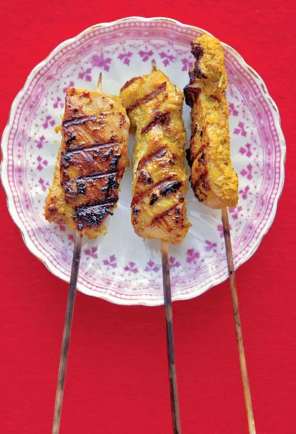 These Malaysian chicken kebabs are marinated in a spice market's worth of seasonings, from ginger to fennel to coriander.