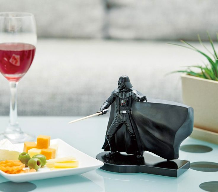 The Darth Vader 'ToothSaber' as so it's called is a little Darth Vader figurine that dispenses toothpicks. Simply push the lever on the back of the figure and Darth Vader will swipe over into his cape...