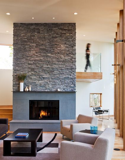 textured stone fireplace surround.  contemporary living room by ALTUS Architecture + Design