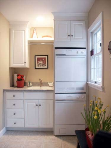 See more laundry rooms by Oscar Acevedo
