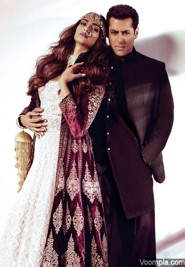 Prem Ratan Dhan Payo couple Sonam Kapoor and Salman Khan in a photo shoot for Harper's Bazaar Bride. Sonam channels the Indian bridal look in a white Abu Jani Sandeep Khosla anarkali and a burgundy JJ Valaya jacket. Salman is wearing a jacket and kurta by Arjun Saluja's Rishta and a Varun Bahl salwar. via Voompla.com