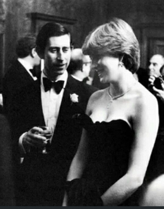 "First royal function as the officially engaged Prince of Wales & Lady Diana Spencer, (wearing the infamous ""shocking"" strapless black gown)"