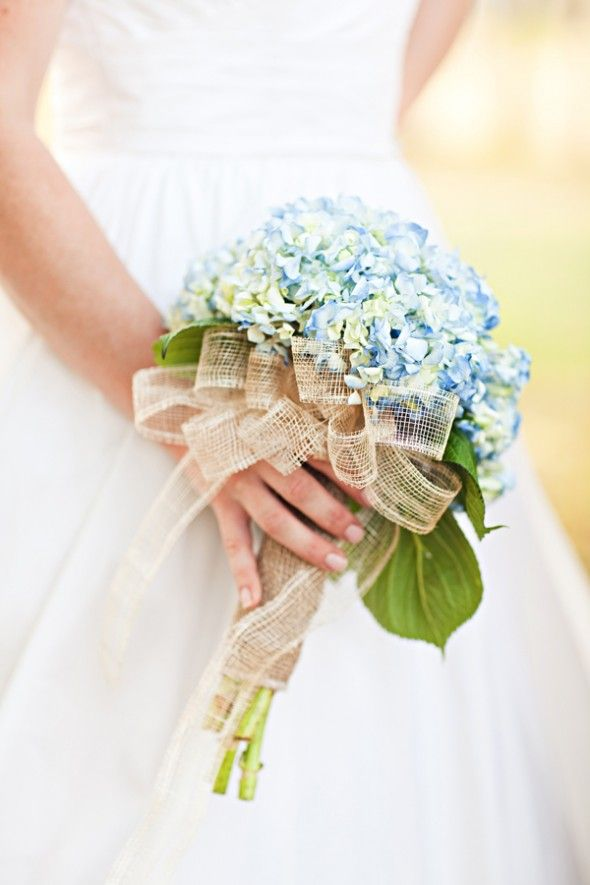 Blue Hydrangea Wedding Bouquet with some white roses, purple lilly's, some green filler flower and a teal and brown wrapping. Peacock colors, with some good old Ogontz green and brown thrown in of course!