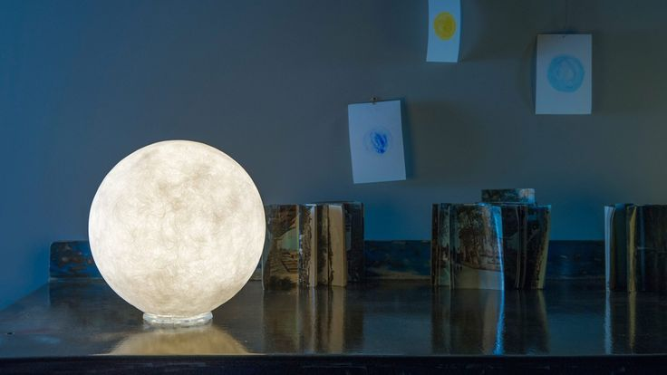 """""""T.moon"""" is inspired by the moon and its lunar matter emphasized by the texture of the material Nebulite.  This metaphoric pendant creates an efficient and functional light source as well as an atmospherical and evocative lighting."""