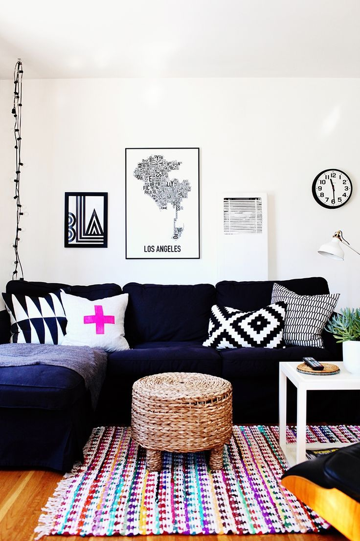 Top 10 Home Tours of 2015 #theeverygirl // colorful living room with a navy couch