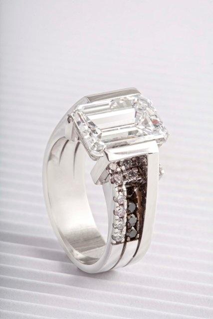 5ct Emerald cut diamond ring - with small white and black diamonds.