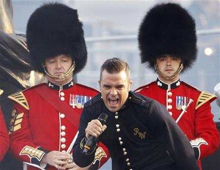 Robbie Williams performs during the Diamond Jubilee concert at Buckingham Palace in London 4 June 2012.