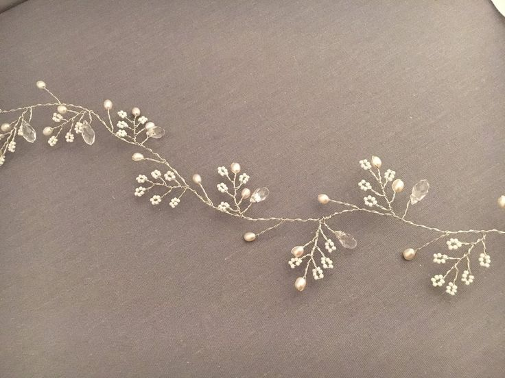 Simply beautiful, this bridal hair vine is put together with delicate pearls, Crystals and white glass seed beads.The pearls are a creamy blush tone.Delicate si