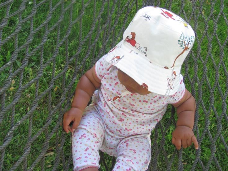 "bucket hat pattern - Oliver + S;   moda fabric - ""little apples""; model - baby N, sitting on hammock"