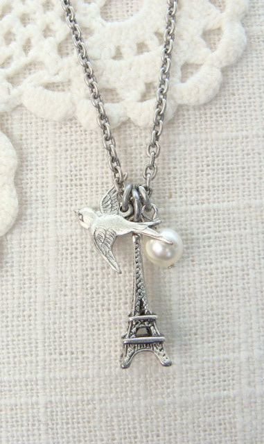 Fly to Paris.  Antique silver charm necklace.