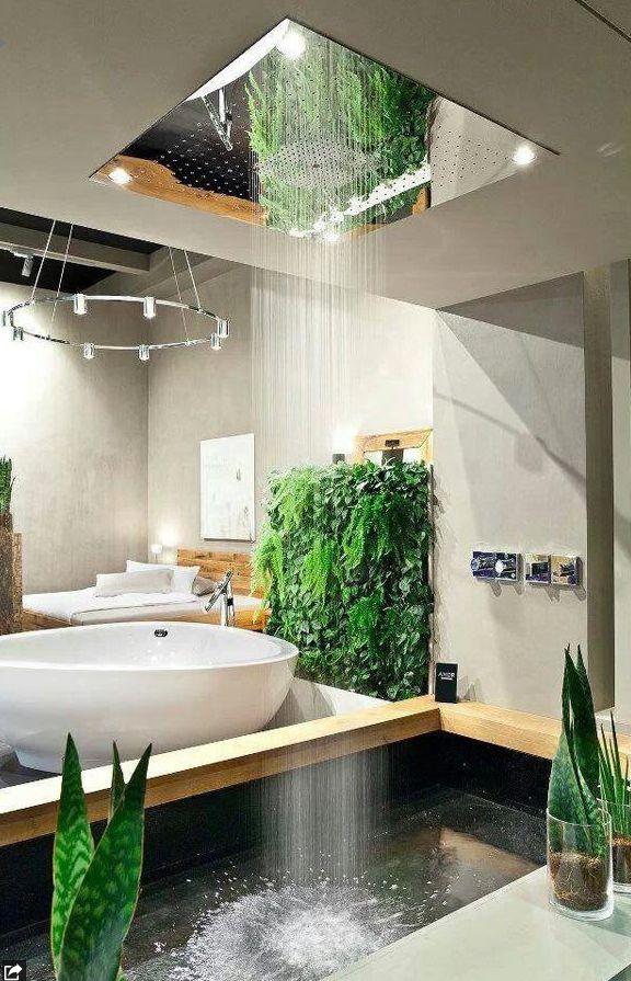 Qui ne rêve pas de cette salle de bain franchement? En plus l'alliage du béton ciré, de l'eau et des plantes nous donne un alliage parfait entre les éléments! Béton ciré que vous pouvez retrouver chez nous!
