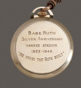"""The pocket watch given to Babe Ruth during his last public appearance at Yankee Stadium in 1948. Culminating the June 13, 1948 event, the Yankees ceremoniously retired Ruth's number three and presented him with the gold watch. The 14 karat gold Longines pocket watch features engravings on the back that read, """"Babe Ruth – Silver Anniversary – Yankee Stadium 1923-1948 """"The House That Ruth Built."""" Since Ruth's death on Aug. 16 of that year, the watch has been preserved by Ruth's family."""