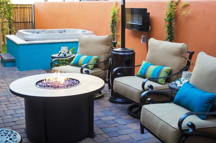 Transitional Hot Tub with Fire pit, Fence, exterior brick floors, Trellis, Gate