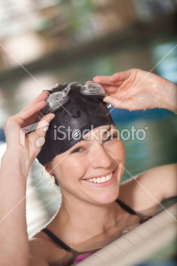 Happy Swimmer With Hat and Goggles at Side of Pool Royalty Free Stock Photo