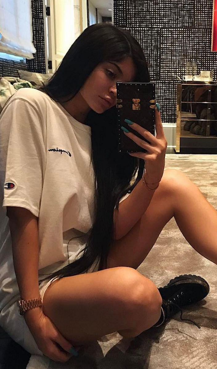 Who made  Kylie Jenner's white tee and black boots?