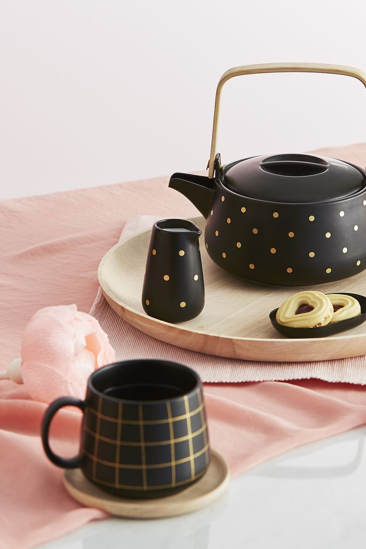 Embrace Swedish design with this gorgeous black and gold polka dot tea set