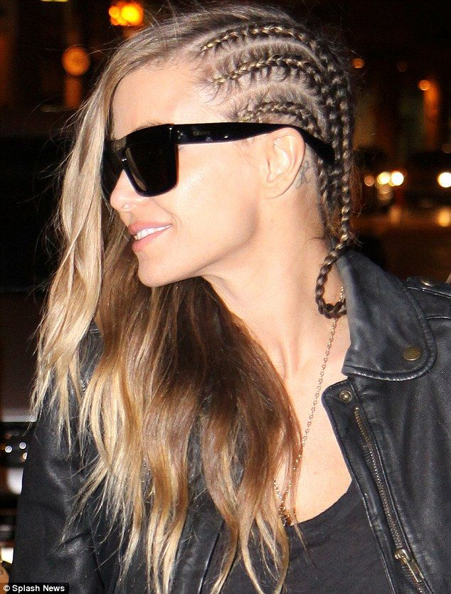 Braid-y lady! Carmen Electra showed off her half corn-rowed hair as she arrived in Toronto, Canada, on Friday
