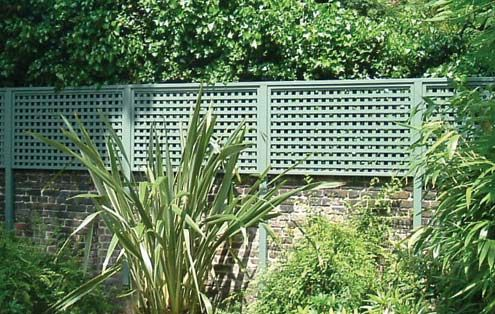 Contemporary Trellis Panels - above a stone wall.  Good for added privacy.