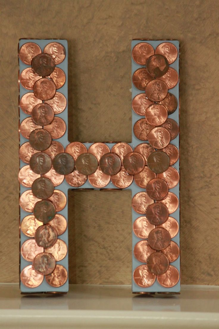 """100 Day activities: """"Bring in 100 things"""" ideas: 100 pennies glued to her cardboard initial."""