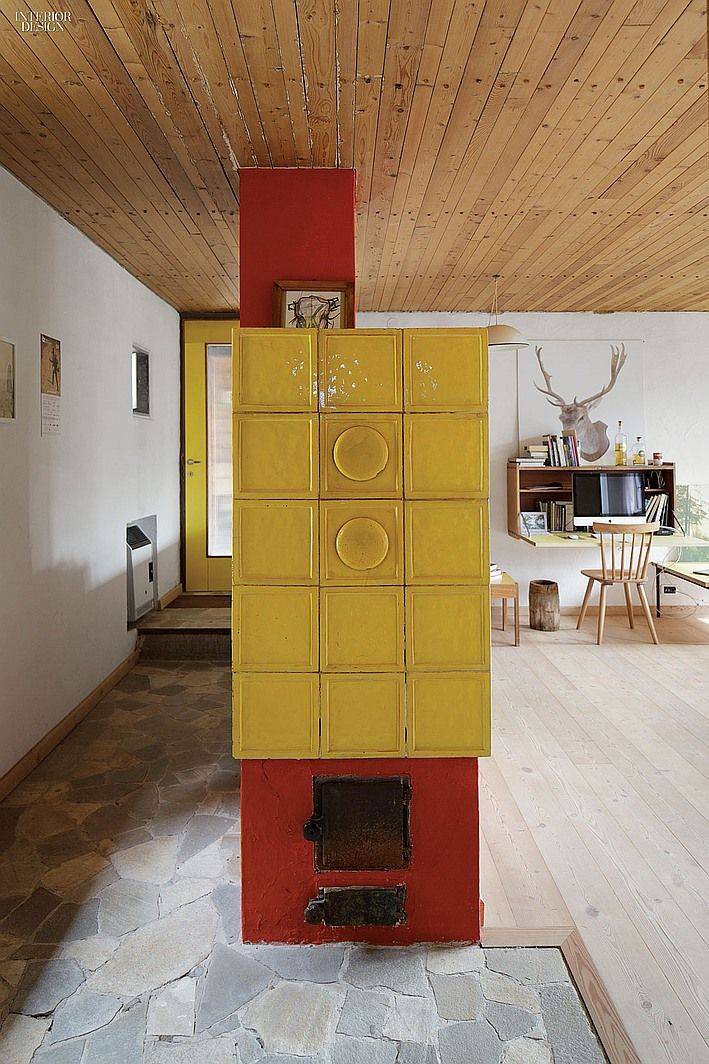 Back to utopia mid century retreat in the alps becomes - Mid century modern wood stove ...