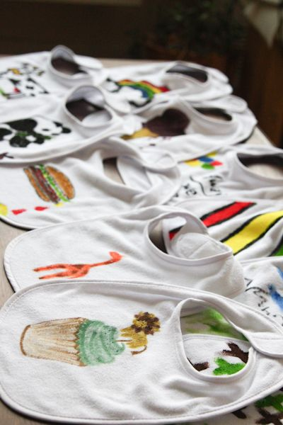 Baby shower idea: bib decorating. Everyone at the party gets a blank white bib and access to every color of fabric markers you can find.