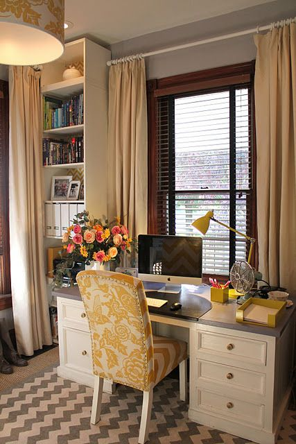 cute office! The yellow chair makes me happy.