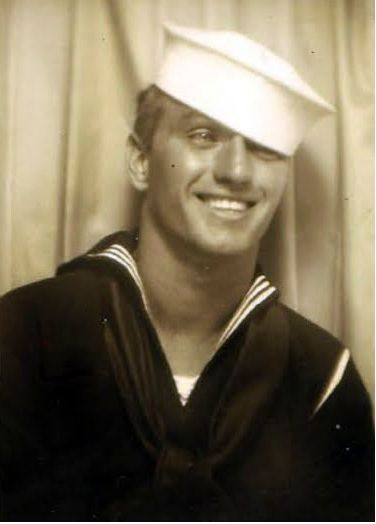 A 1940s sailor smiling for a photo booth