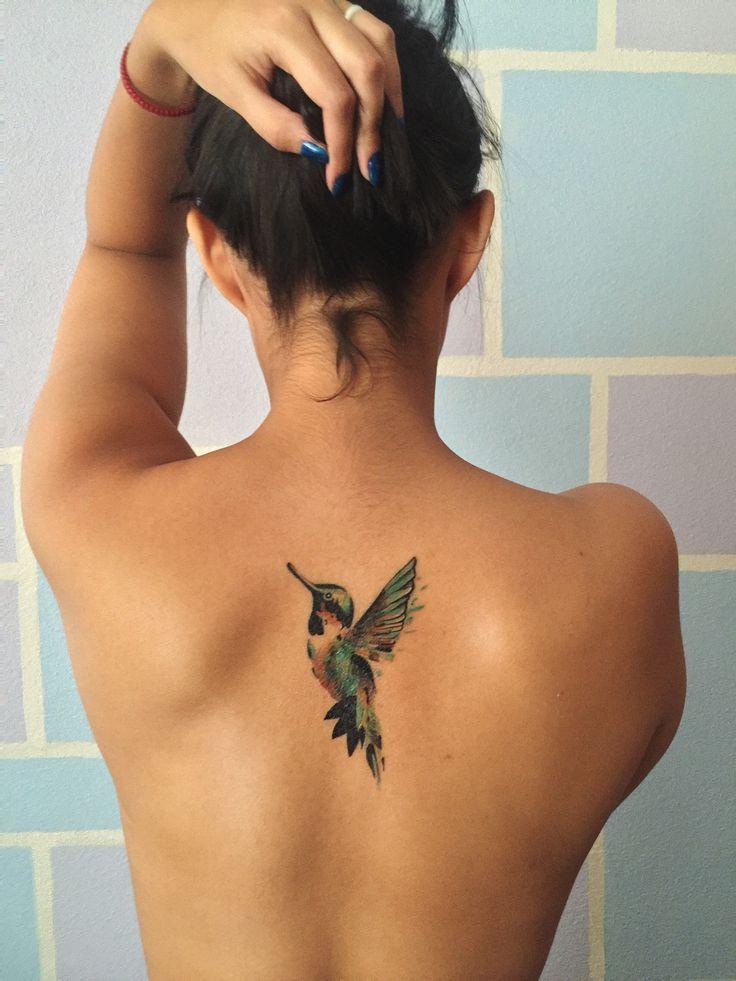 Humming bird color tattoo