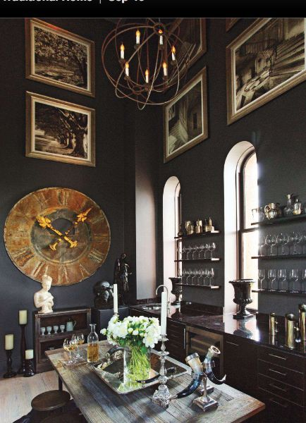 Amazing A wine room is furnished with a large antique bronze clock and dramatic wall paint from Pratt u Lambert Traditional Home Photo Eric Roth Design