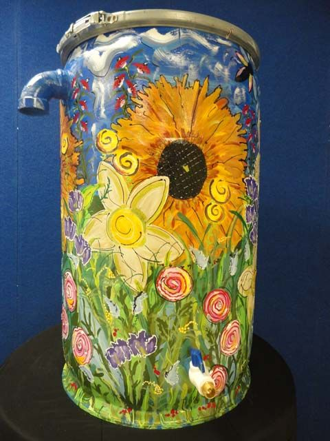 Many amazing Rain Barrel Designs. Keep clicking next to see them all.  This shows they do not have to be ugly, but these will require artistic talents which I don't have, LOL.