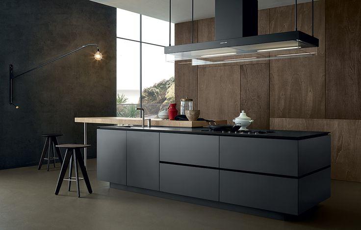 Betonlook, hout en een strak vormgegeven keukenblok. Mooie combinatie!
