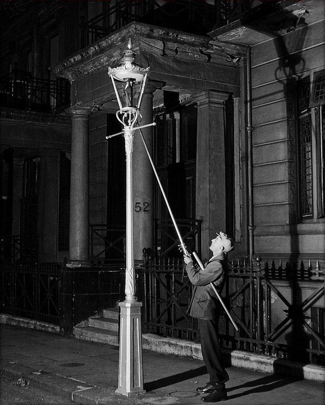 Lamplighter, Kensington, London, 1930. Gas street lighting.