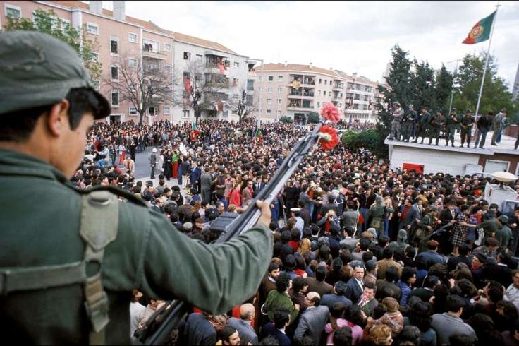 """April 25,   1974: BLOODLESS MILITARY COUP IN PORTUGAL  -    The """"Carnation Revolution"""" takes place in Portugal as a bloodless military coup topples the Estado Novo regime."""